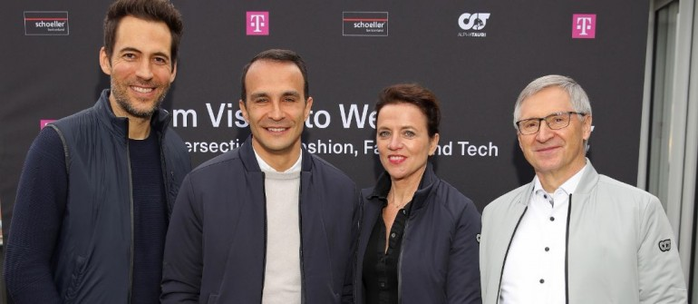 """BERLIN, GERMANY - JANUARY 14: Alexander Mazza, General Manager Alphatauri Ahmet Mercan, Vice President Brand Experience at Deutsche Telekom Antje Hundhausen and CEO Schoeller Textil AG Siegfried Winkelbeiner pose during the """"Launch of Heatable Capsule Collection"""" between Telekom, AlphaTauri and Schoeller on January 14, 2020 in Berlin, Germany. (Photo by Andreas Rentz/Getty Images for Images for AlphaTauri, Telekom & Schoeller)"""